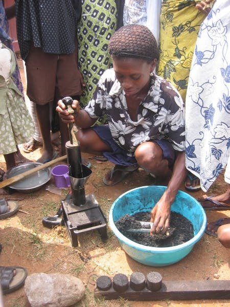 Making the high-density briquettes using a press, Jukwa market, Ghana, 2005