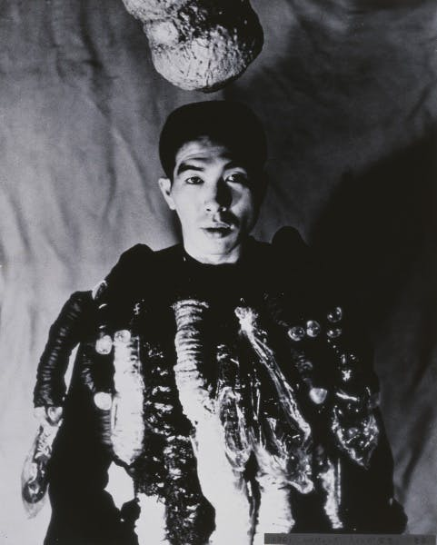 Portrait of Tetsumi Kudo with his work Philosophy of Impotence in 1962