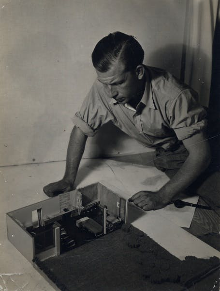 Eero Saarinen with A Combined Living-Dining-Room-Study project model, created for Architectural Forum magazine, circa 1937