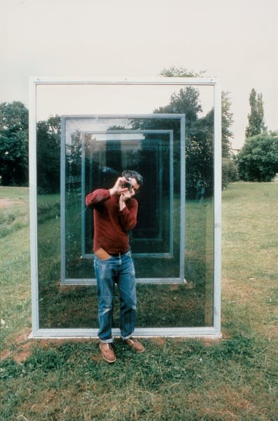Dan Graham photographing Two Adjacent Pavilions, 1978-1982