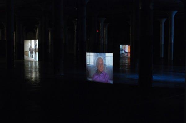 Installation view of Tacita Dean's Merce Cunningham performs STILLNESS… (six performances, six films) at Dia: Beacon, NewYork.