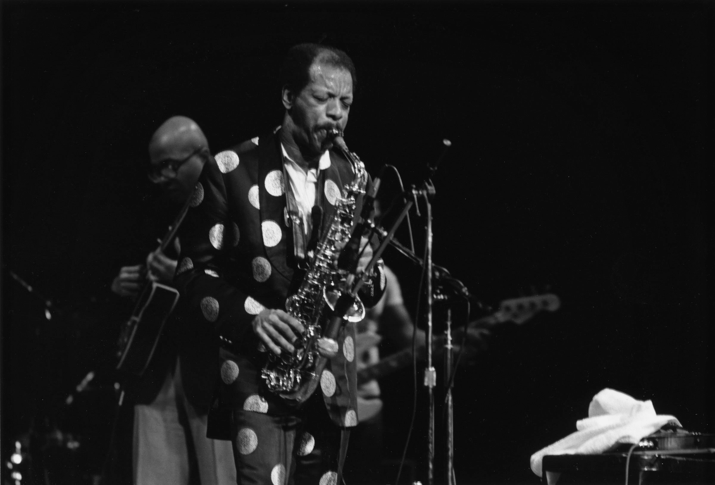 Ornette Coleman on stage in a dotted suite
