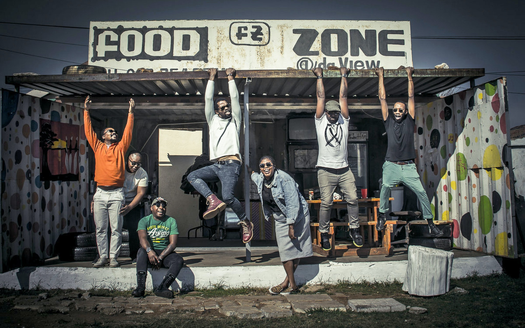 BCUC posing under a sign that says food zone.