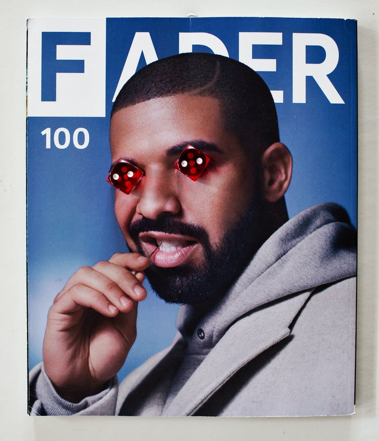 magazine cover of man with dice on eyes