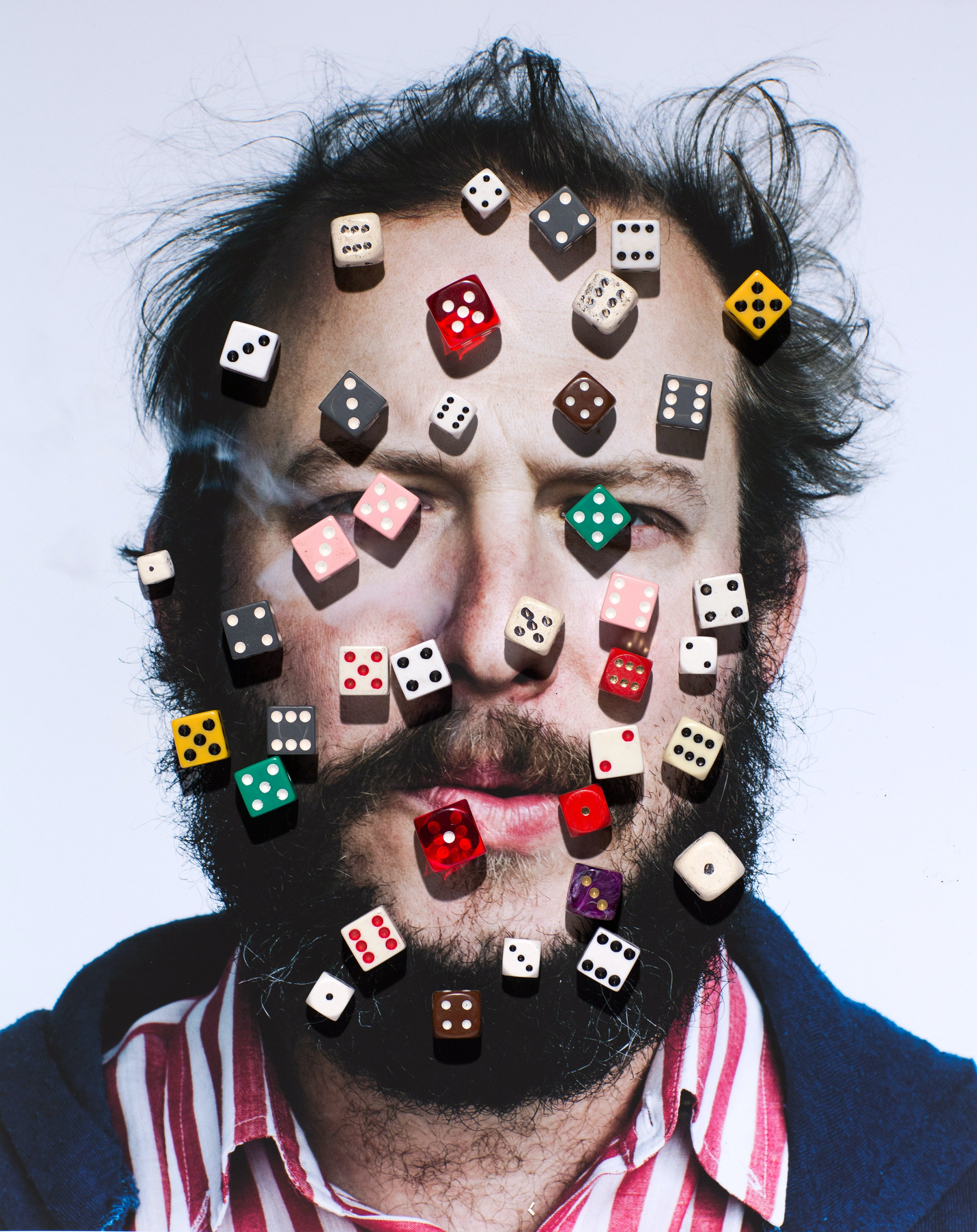 picture of a man with many dice on top