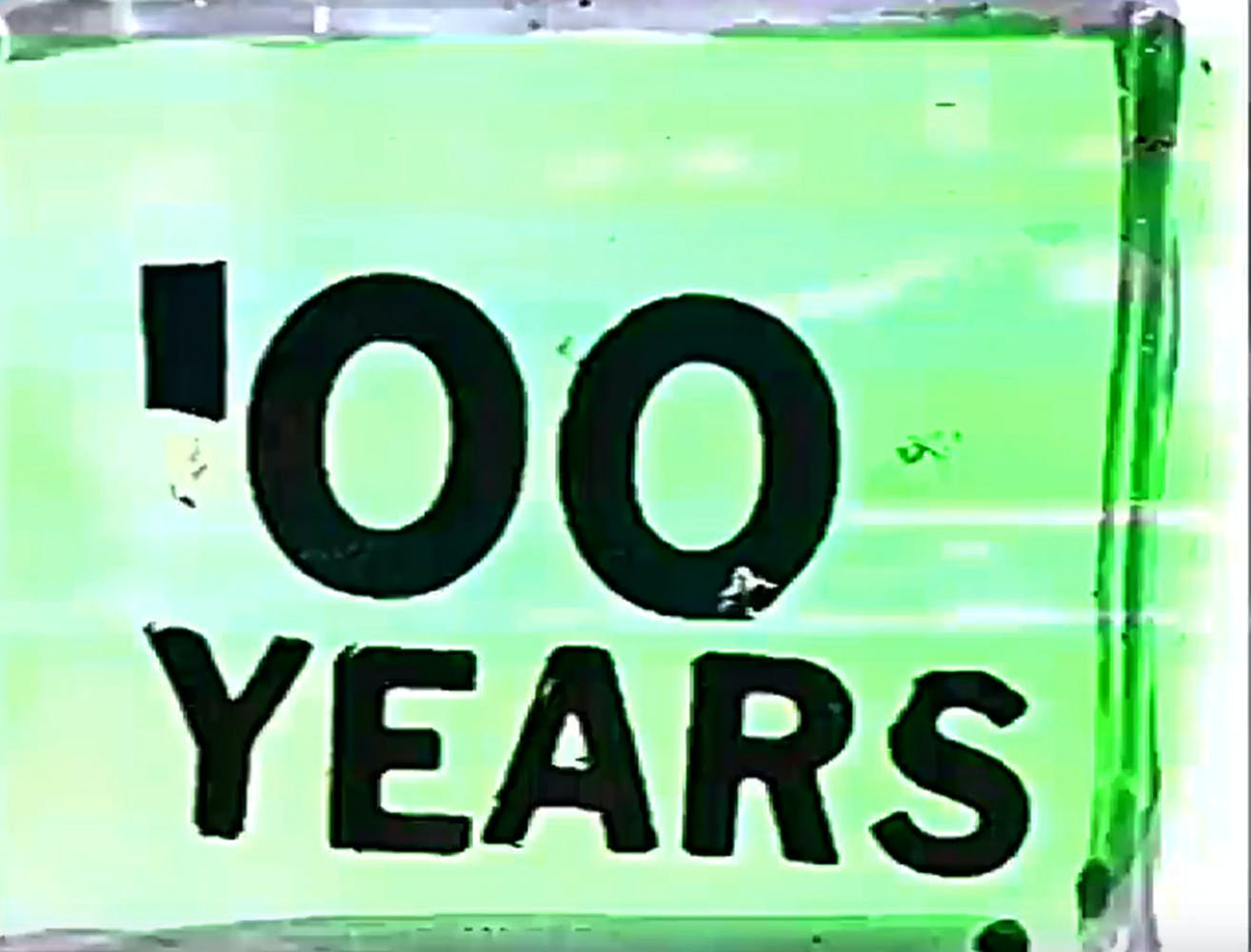 """Green background with large black collaged text that says """"'00 YEARS"""""""