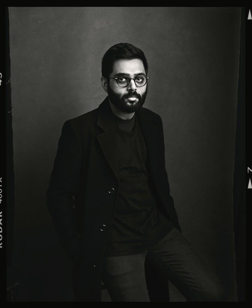Rafiq Bhatia standing, black&white image.