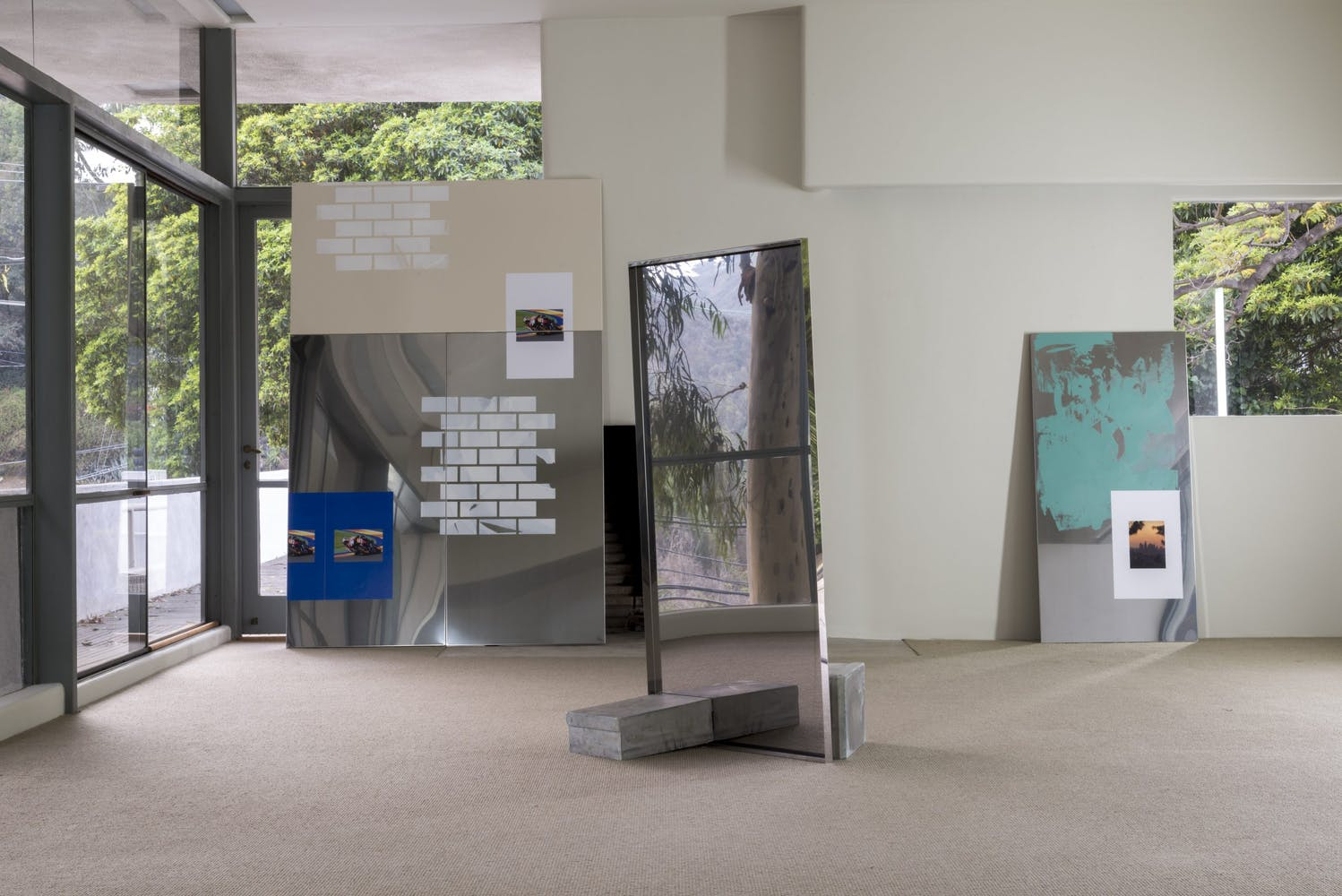 Image of lobby space with images and mirrors laying against walls