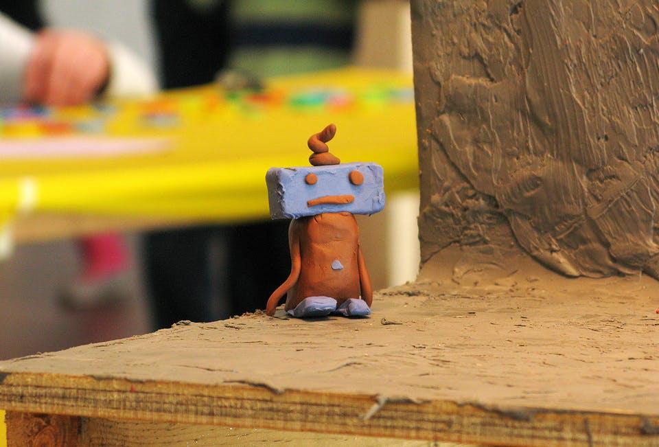 Blue and orange clay figure.
