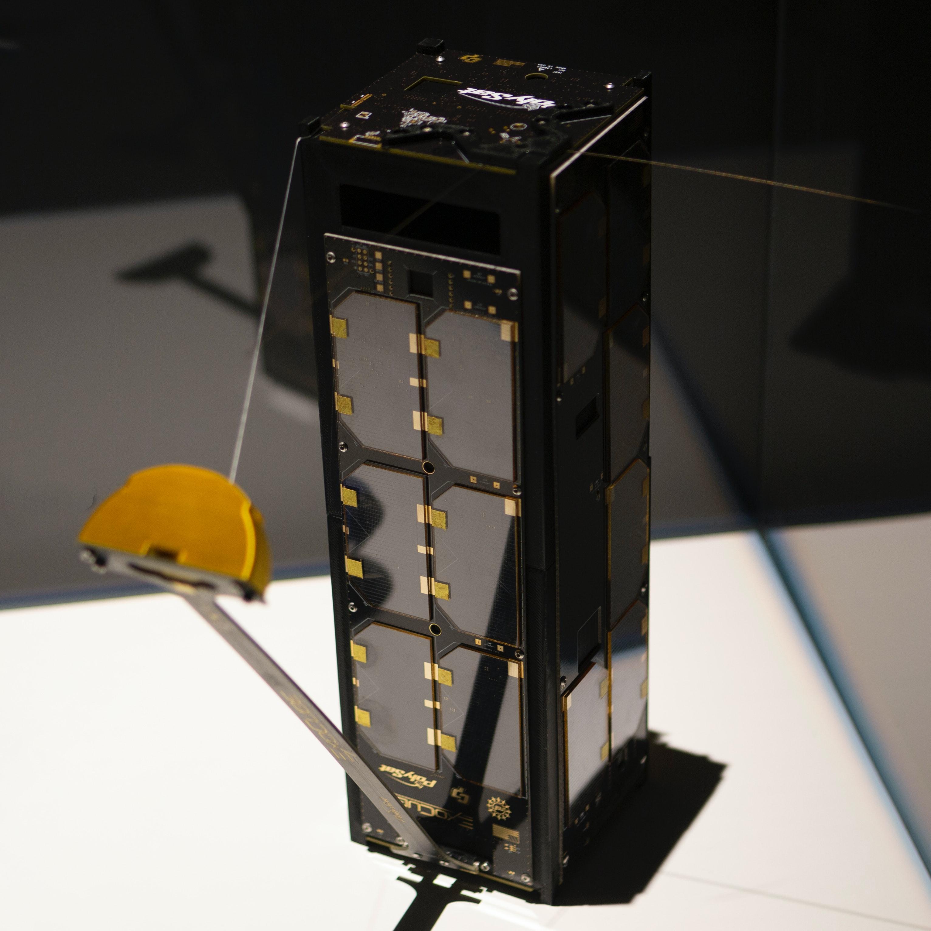 Image of rectangular satellite on display in vitrine