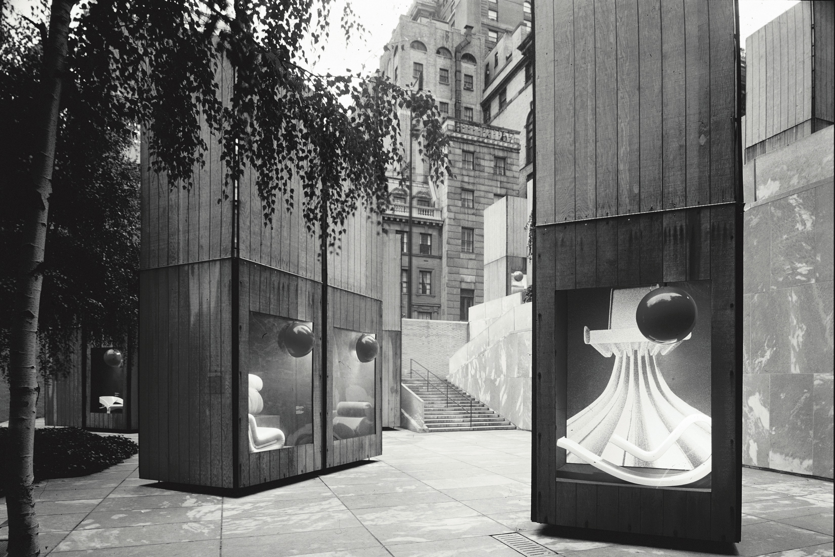 Image of objects in cases outdoors as part of exhibition display