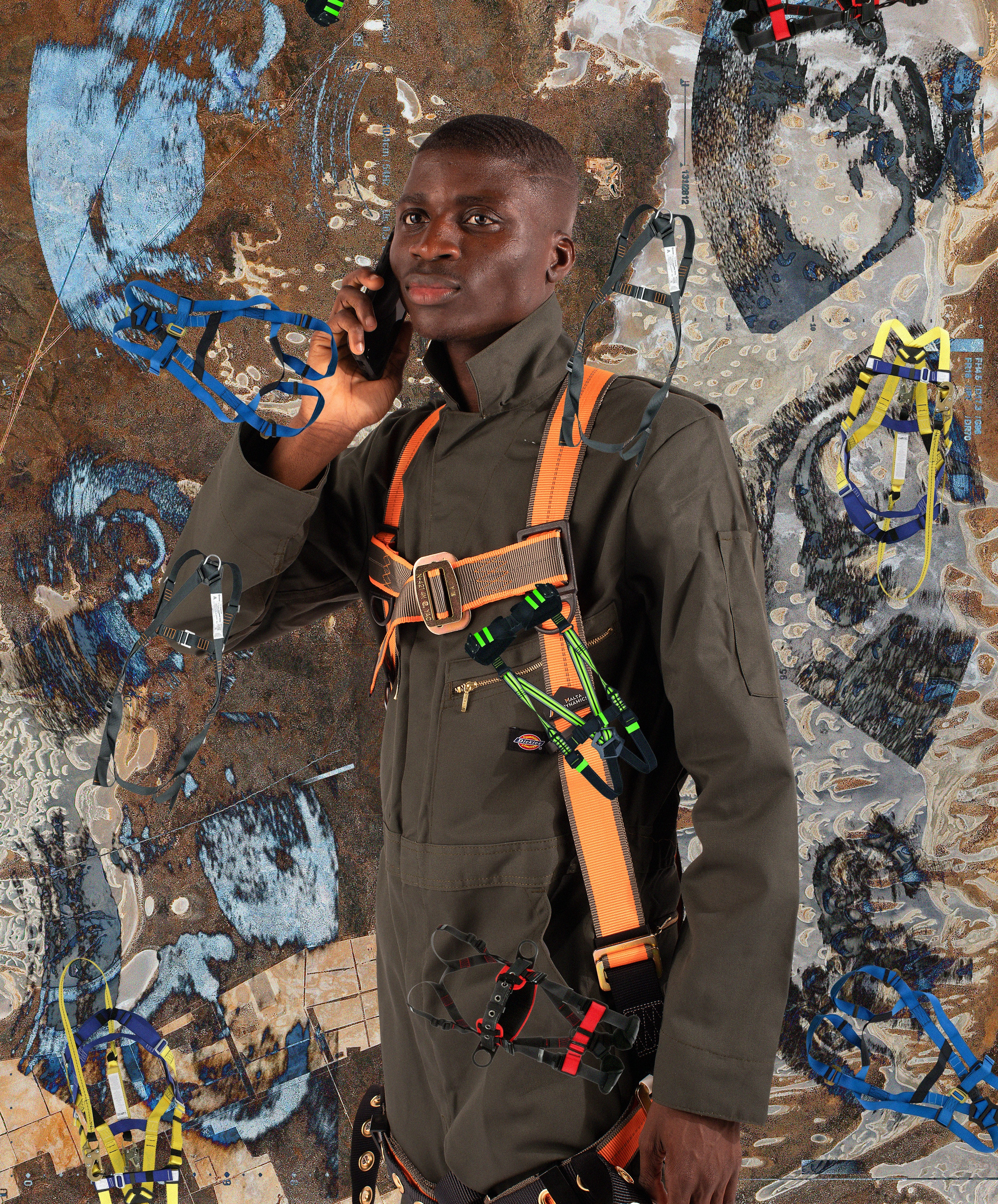Stylized collage of man in work gear holding cell phone on top of abstracted background with harnesses and sonograms