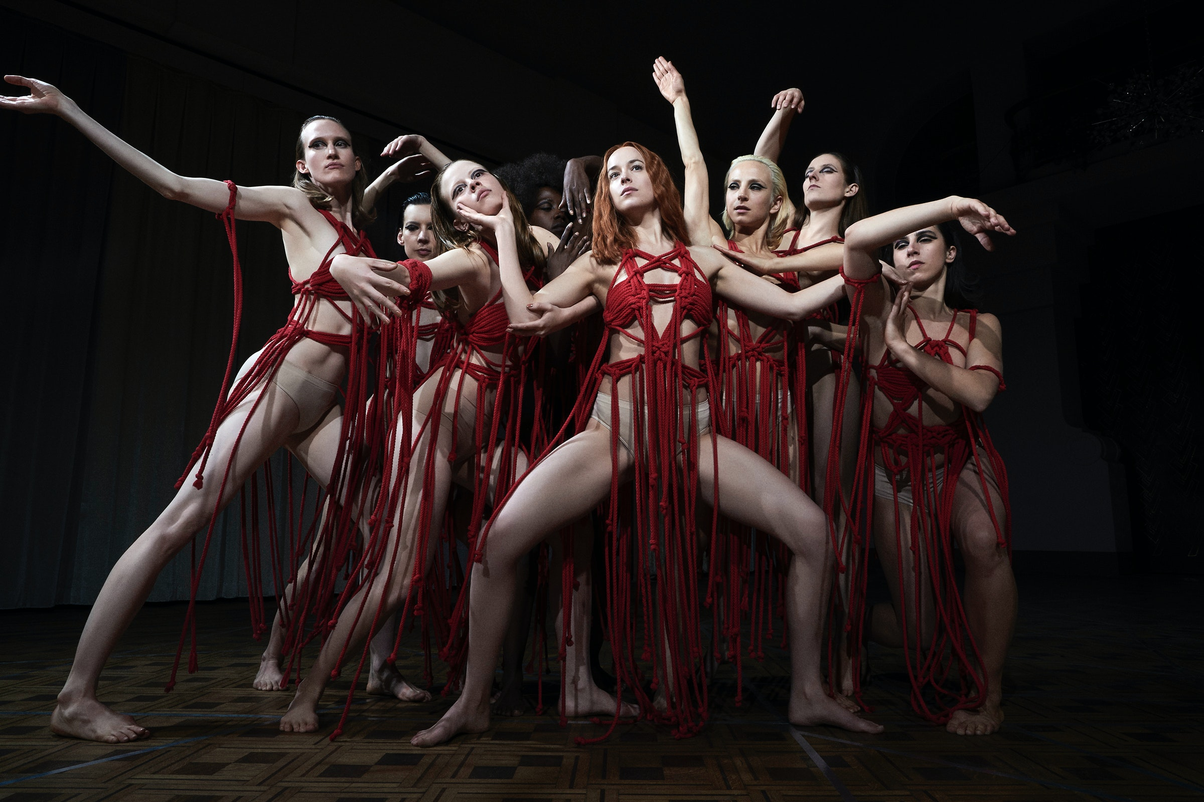 Dancers wearing in red in formation