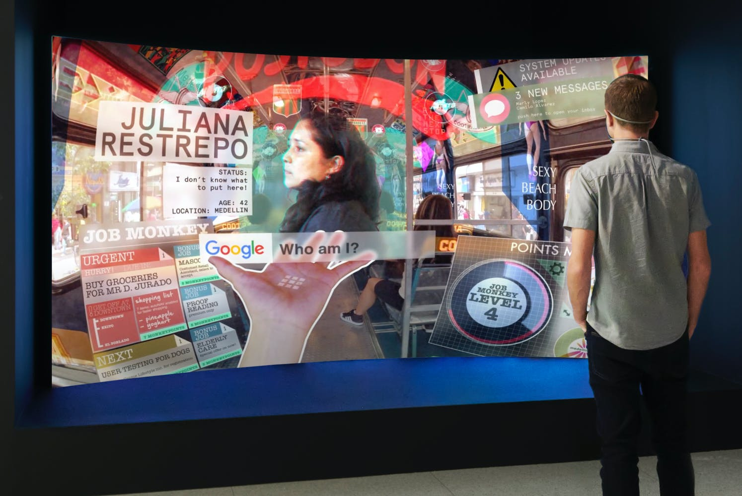 Man standing in front of large rounded projection screen displaying a futuristic user interface