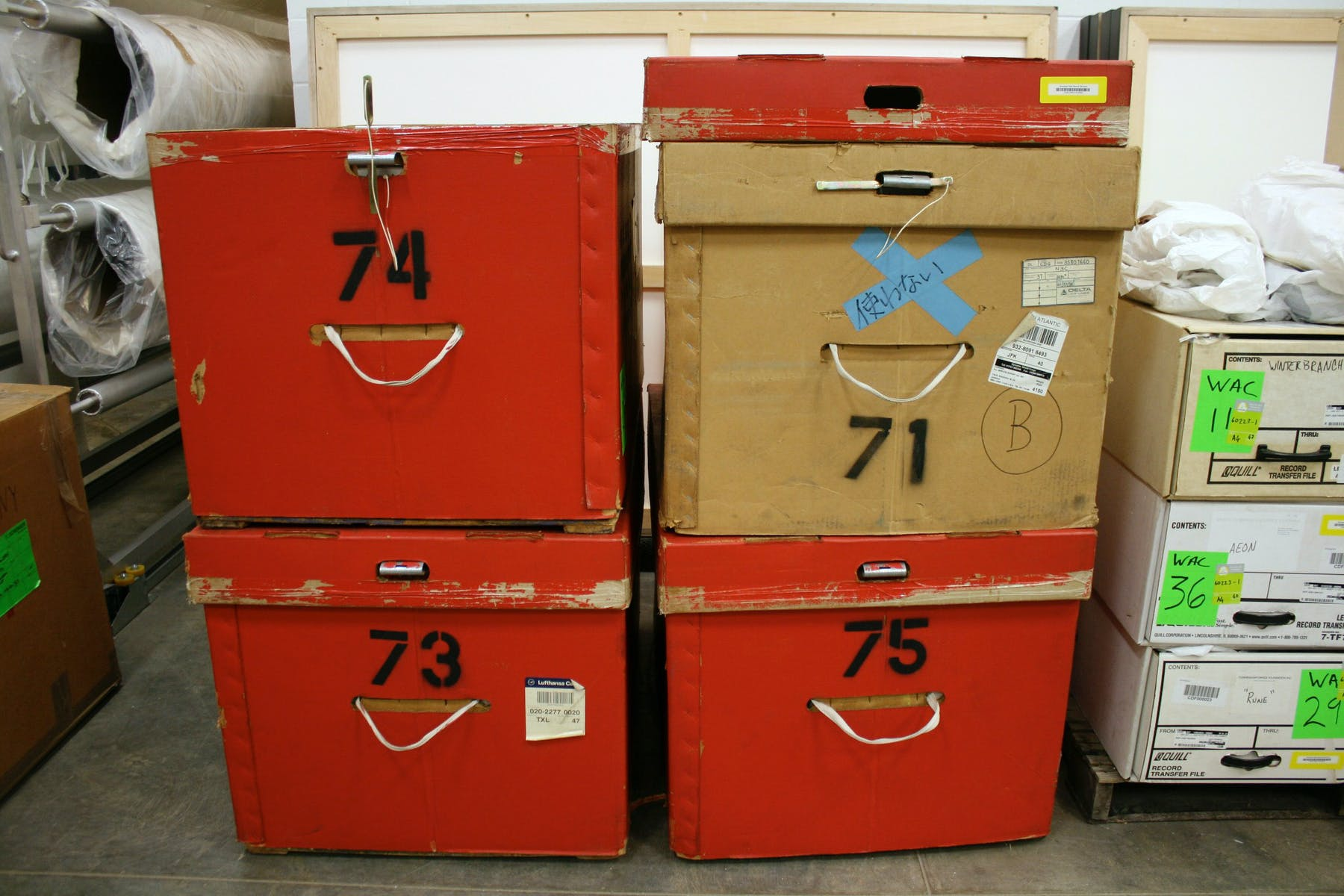 Costume boxes from the Cunningham Dance Foundation's New York facilities and their contents were sorted and cataloged in the Walker's painting storage room.