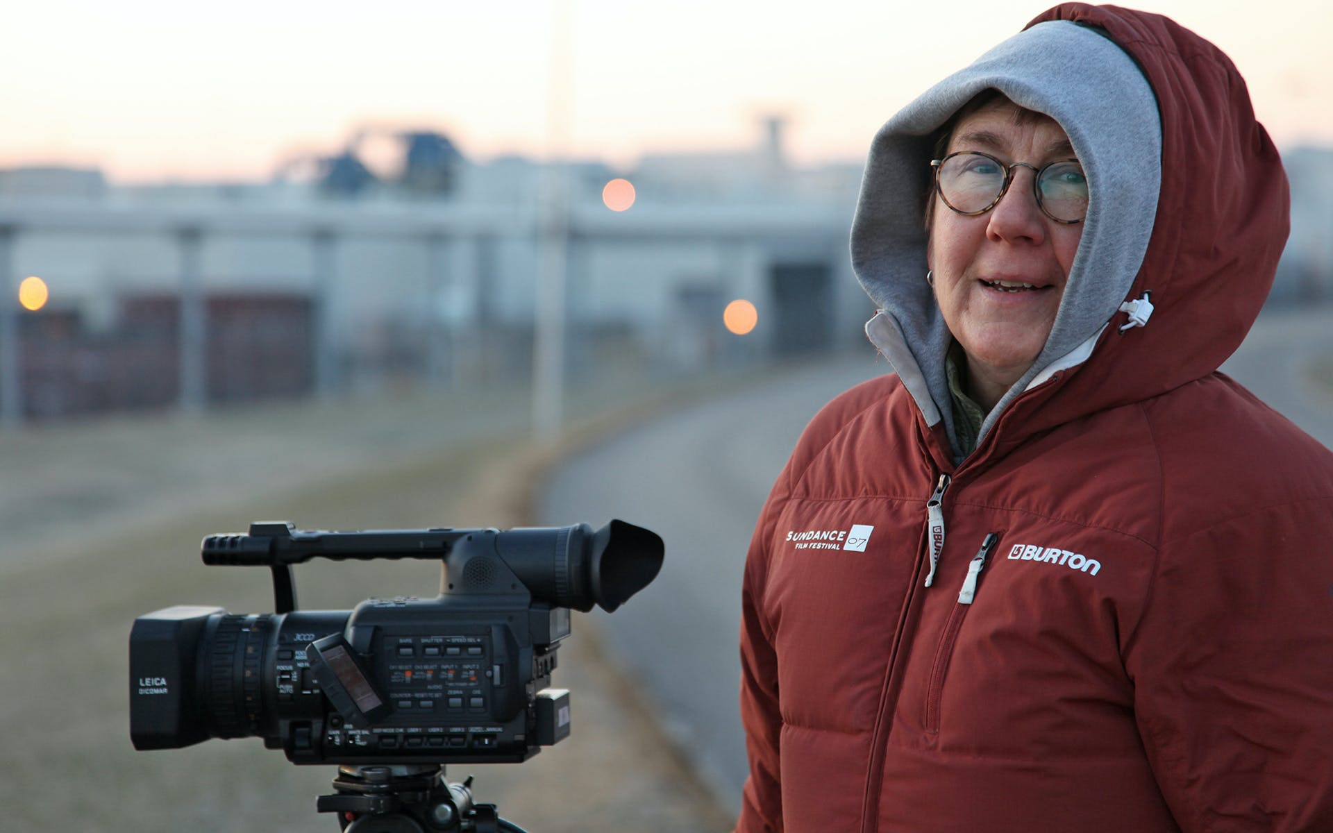 Julia Reichert in front of film camera.