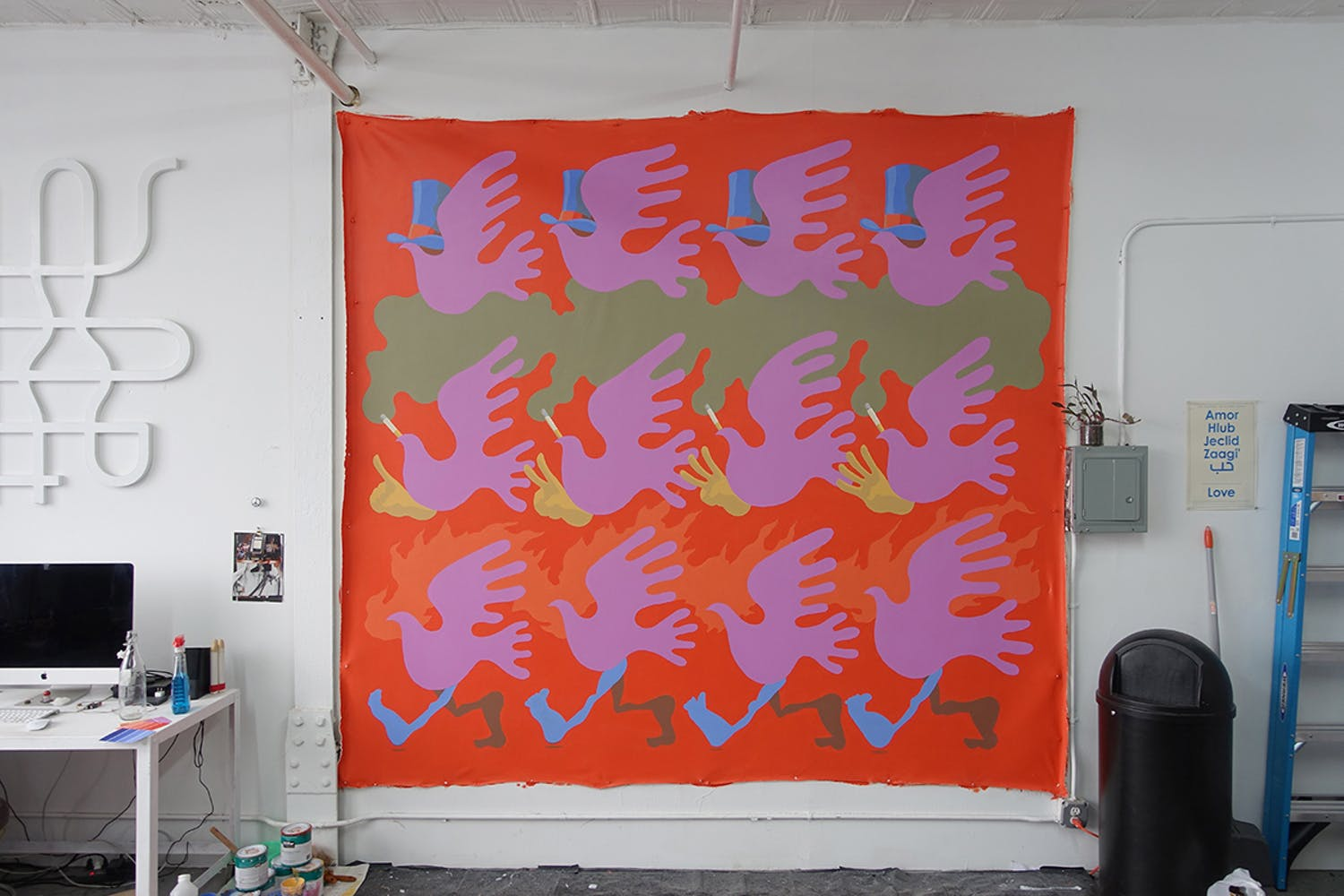 Painted canvas featuring repeated dove pattern in bright colors