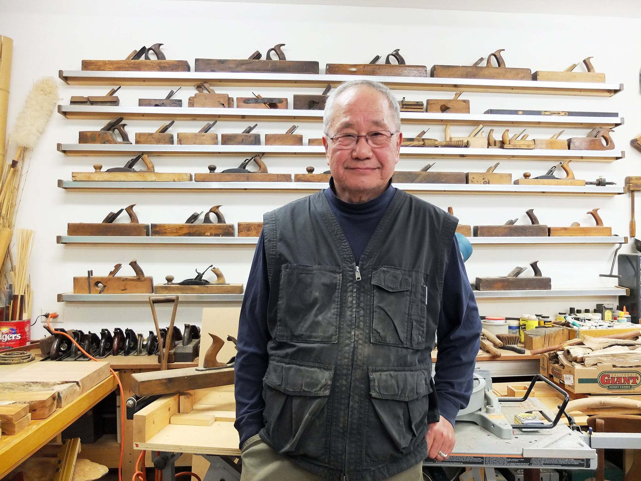 Kinji Akagawa standing in workshop.