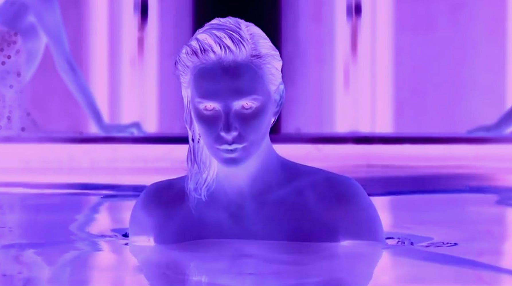 Inverted purple image of woman in water
