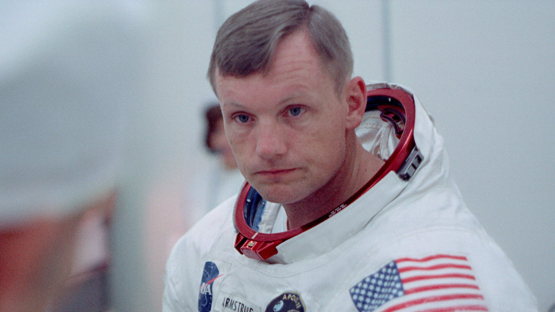 Astronaut Neil Armstrong in an astronaut uniform, helmet off.