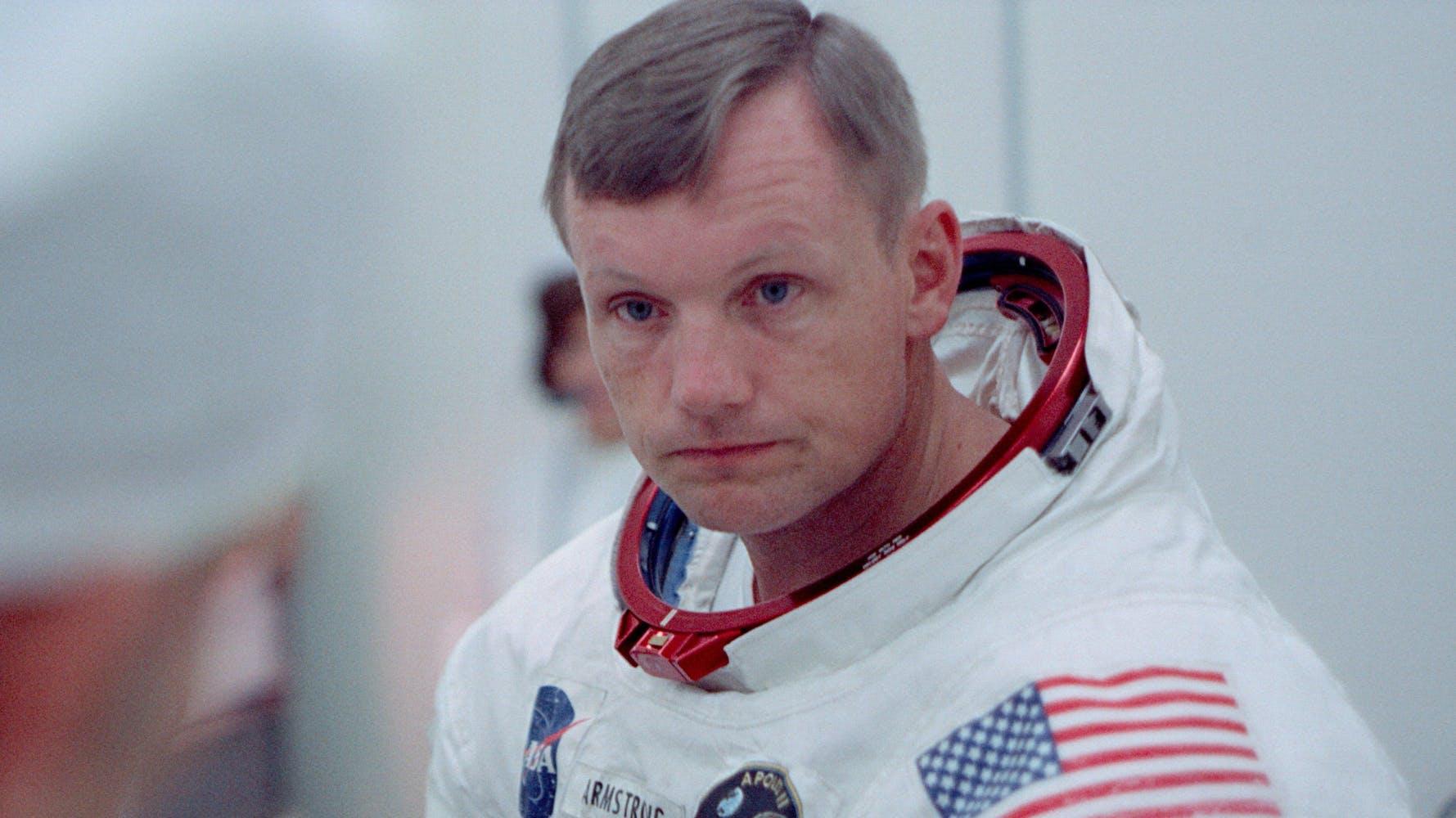 Astronaut Neil Armstrong in an astronaut uniform, helmet off.