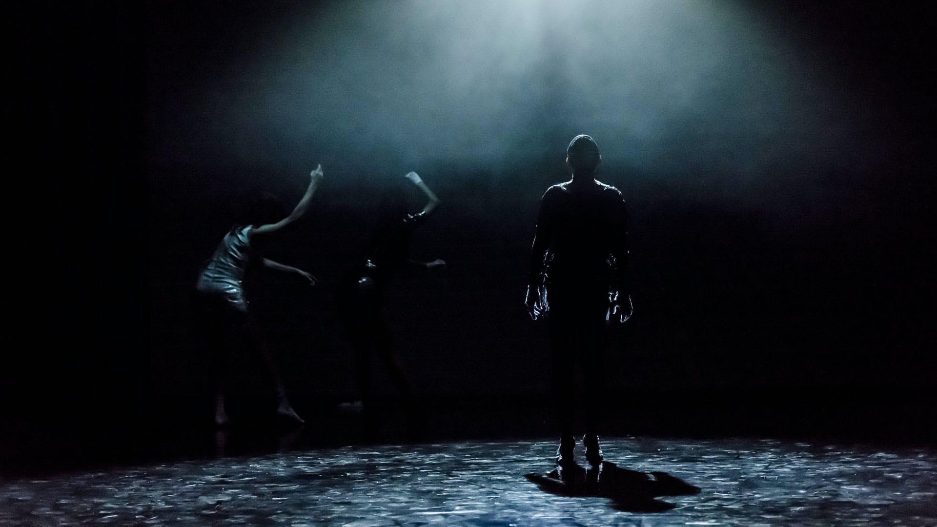 People dancing on dark stage