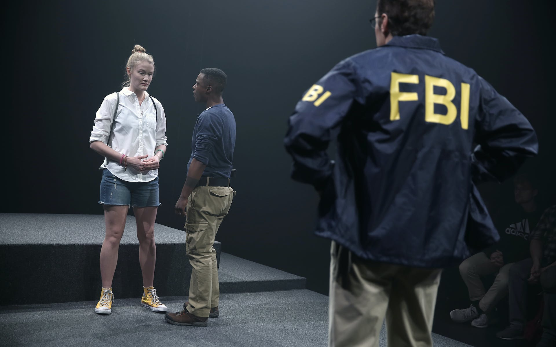 Woman being questioned by FBI agents.