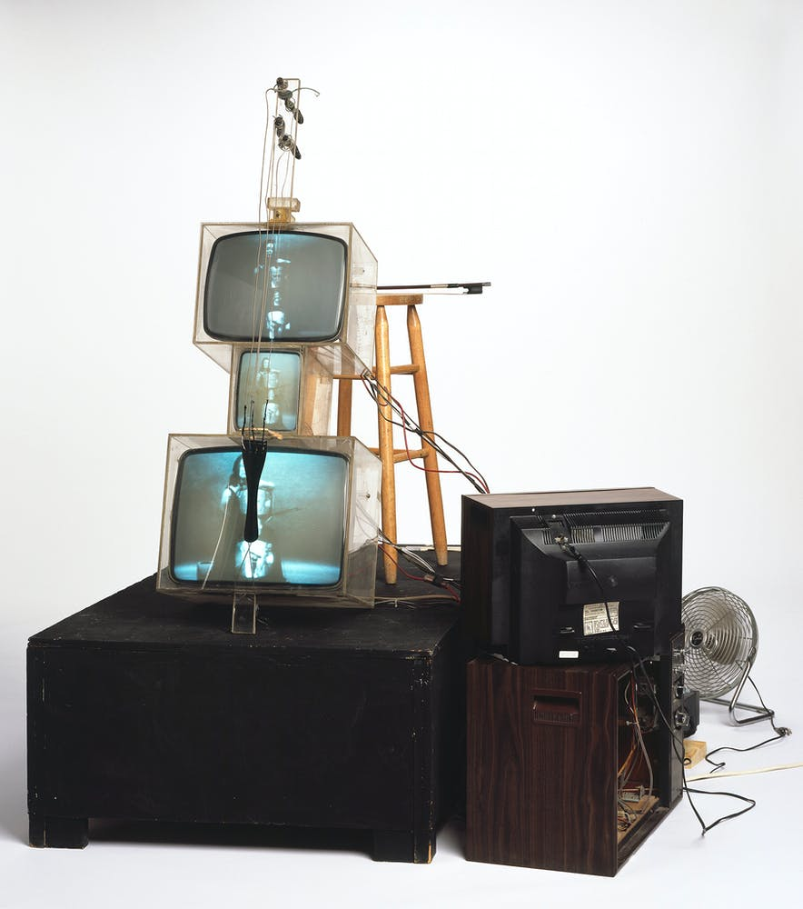 Nam June Paik, TV Cello, 1971, video tubes, TV chassis, plexiglass boxes, electronics, wiring, wood base, fan, stool, photograph. © Estate of Nam June Paik. Courtesy Walker Art Cente