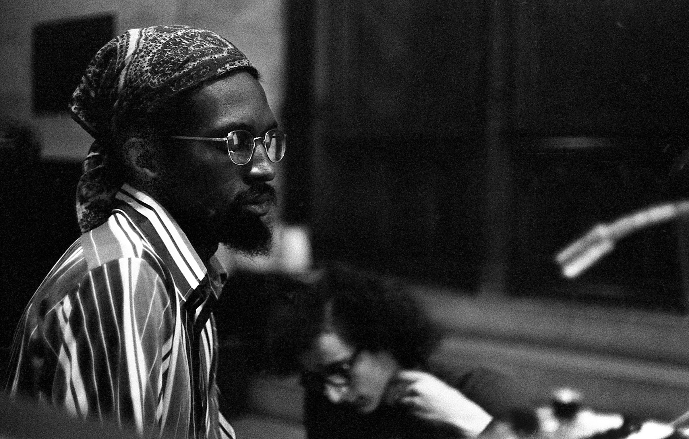 Portrait of Julius Eastman sitting at a piano