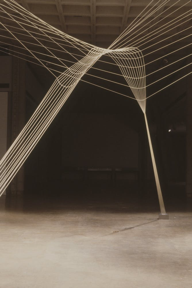 Sculpture consisting of taut wires intersecting