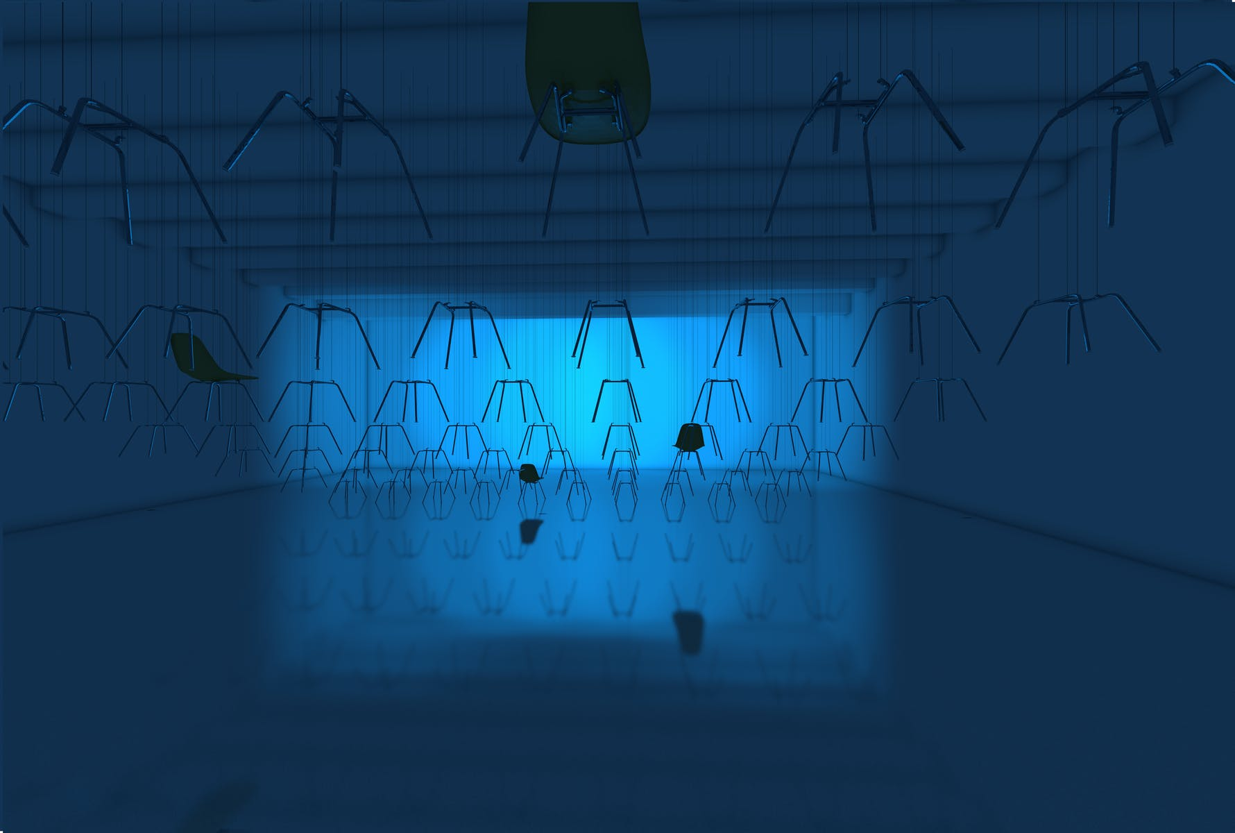 Gallery bathed in blue light with dozens of chair legs hanging from the cieling