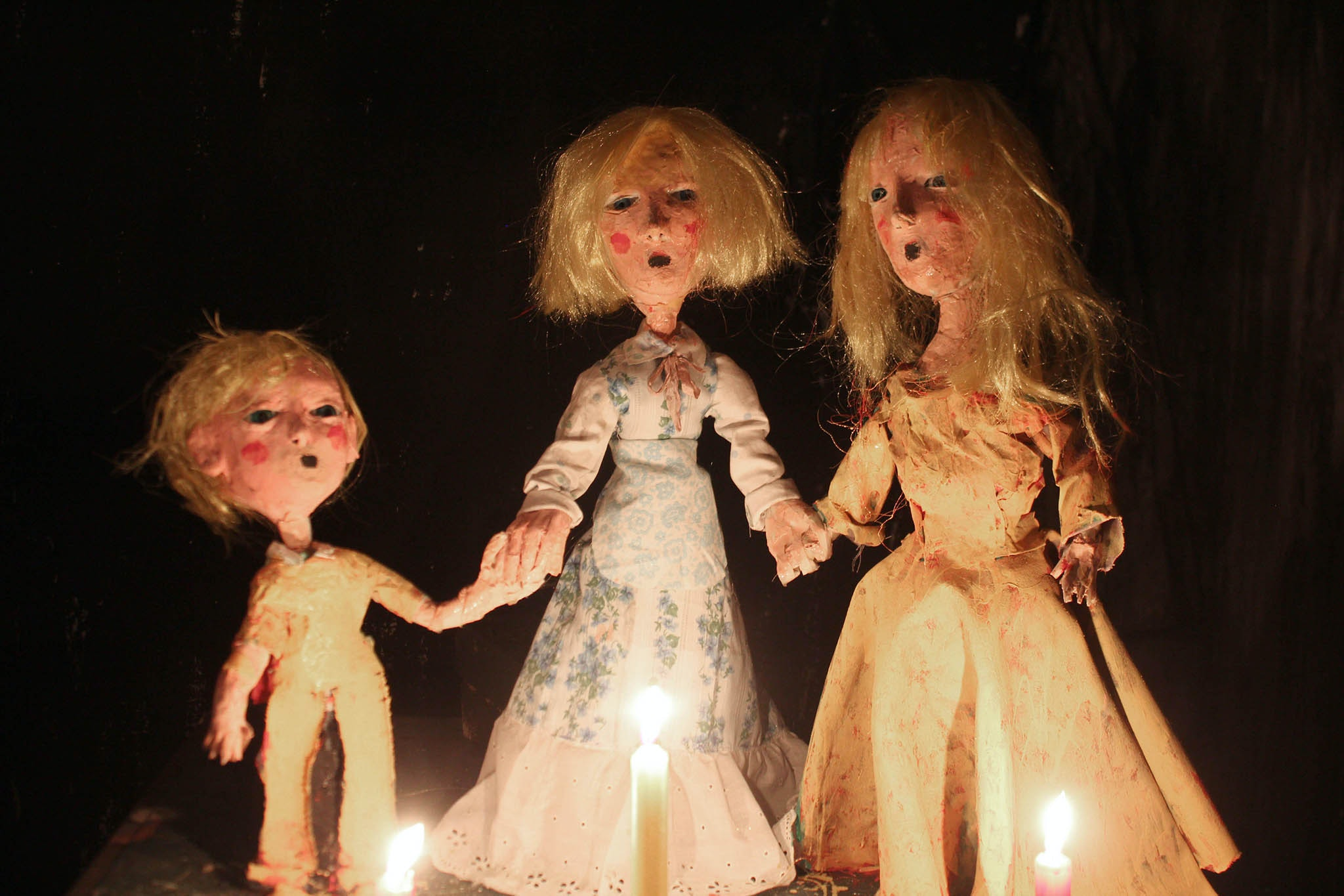dark picture with dolls
