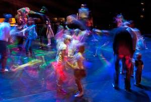 motion blur children dancing under black lights