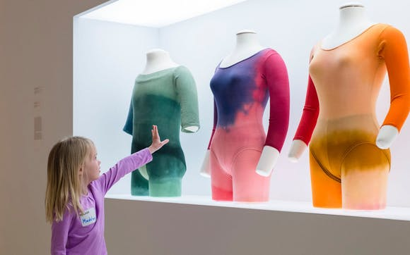 Grade school-aged students tour the Cunningham galleries and engage in an Art Lab activity.