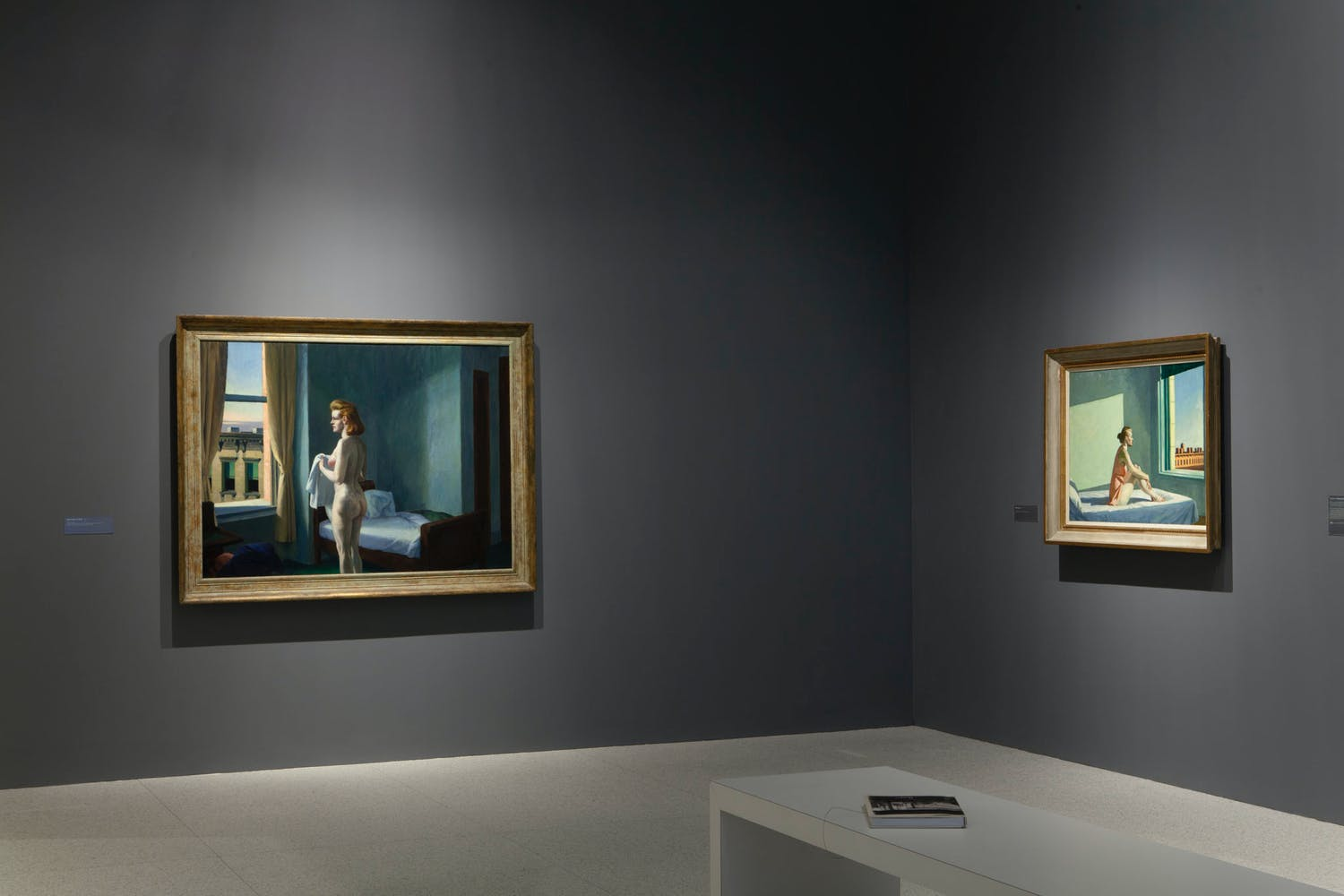 View of the exhibition Hopper Drawing: A Painter's Process, 2014; (left to right): Edward Hopper, Morning in a City, 1944; Edward Hopper, Morning Sun, 1952