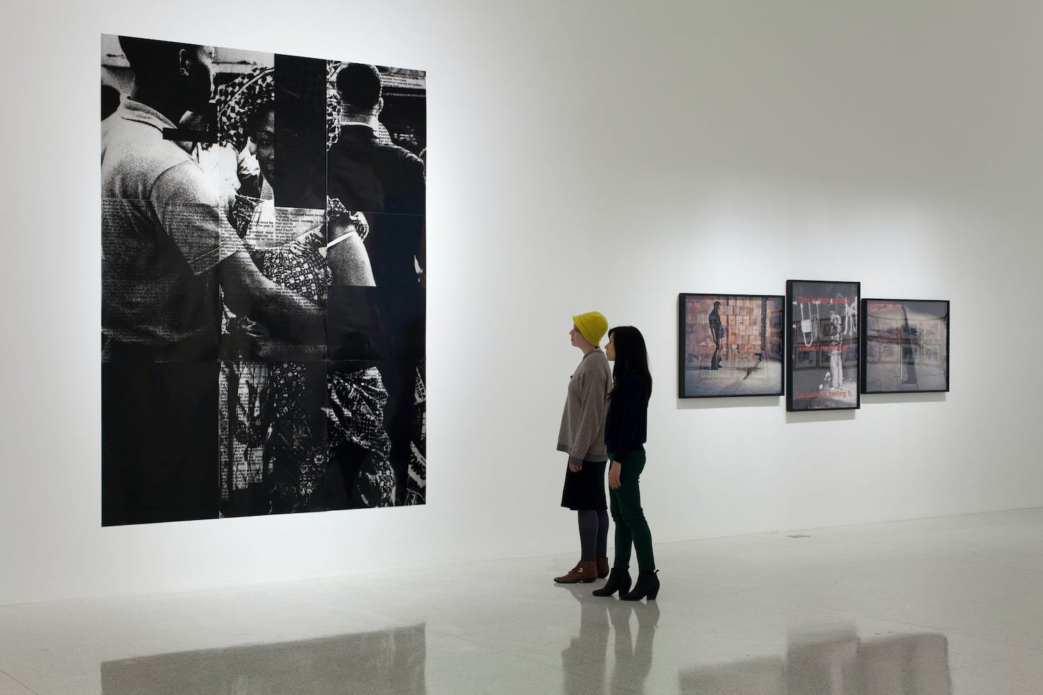 View of the exhibition Radical Presence: Black Performance in Contemporary Art, 2014; (left to right): Adam Pendleton with Jaan Evart and Marc Hollenstein, Black Dada (Ian Berry, couple dancing, independence celebration Congo, 1960), 2008/2012; Clifford Owens, Anthology (Glenn Ligon), 2011