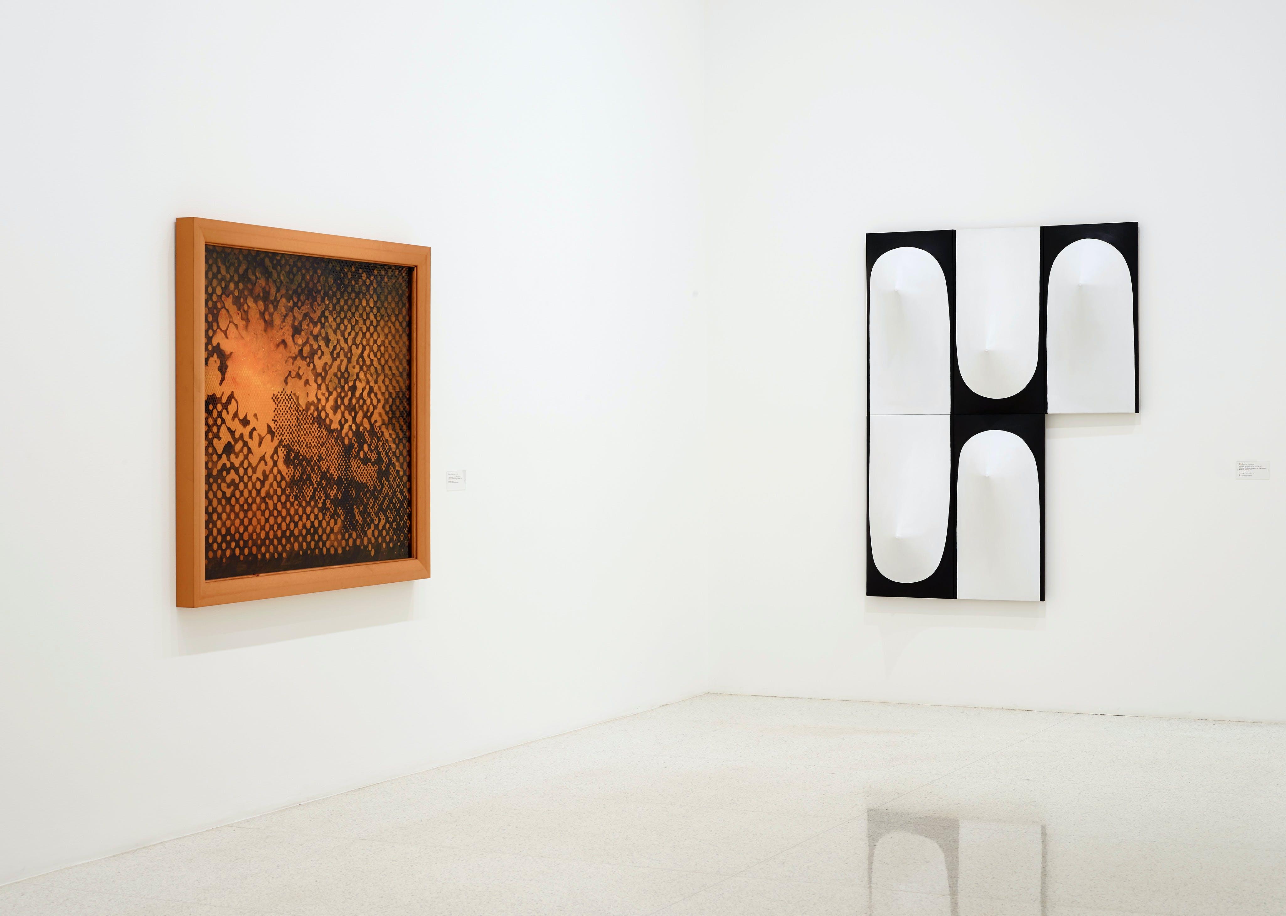 View of the exhibition 75 Gifts for 75 Years, 2015; (left to right): Sigmar Polke, ...solange die mit der Wirklichkeit verbindenden Beziehungen fehlen, 1998; Zilia Sánchez, Troyanas, políptico (de la serie Módulos Infinitos) [Trojans, polyptych (of the Infinite Modules series)], 1967