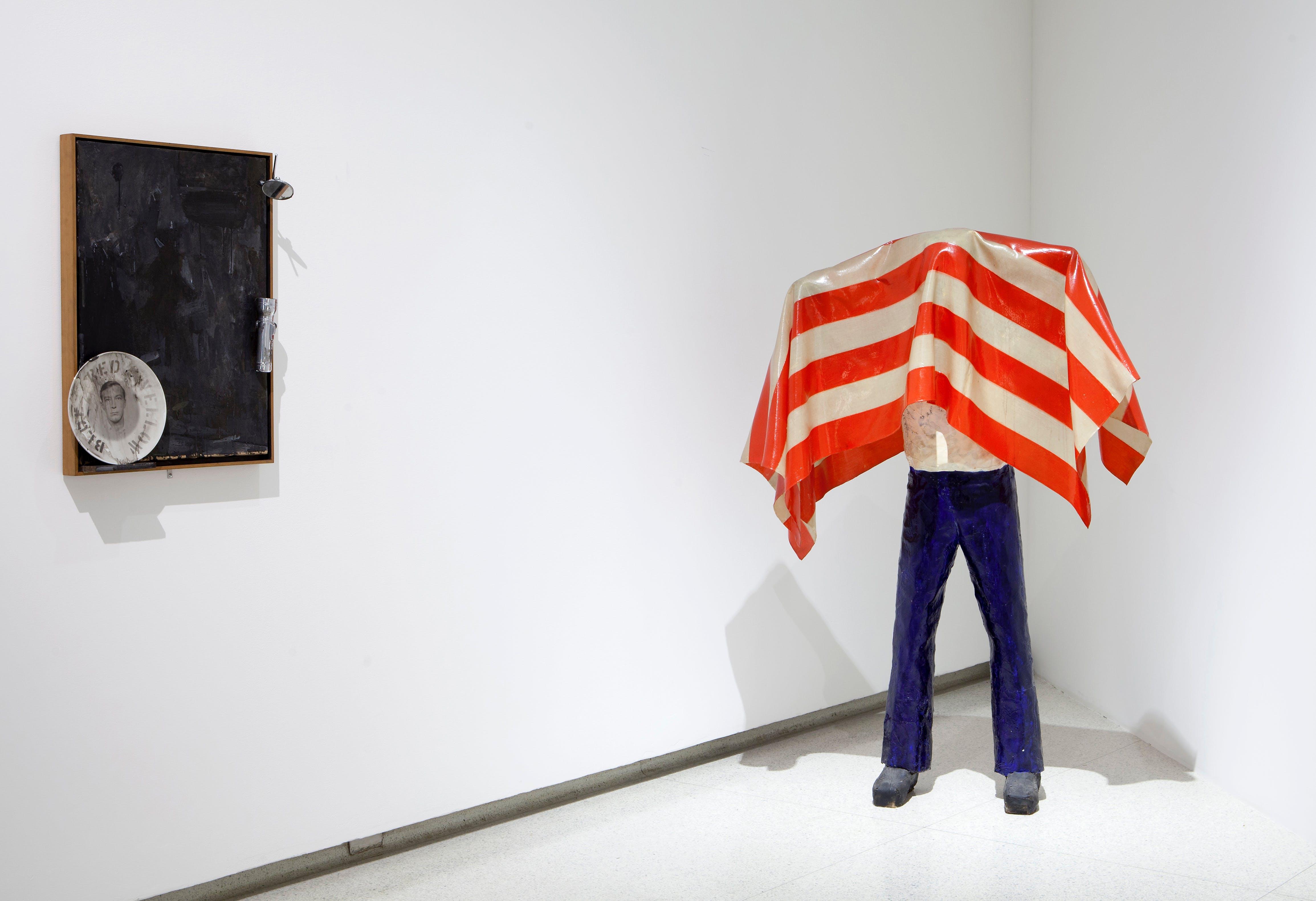 View of the exhibition International Pop, 2015; (left to right): Jasper Johns, Souvenir, 1964; Kojima Nobuaki, Untitled (Figure), 1976