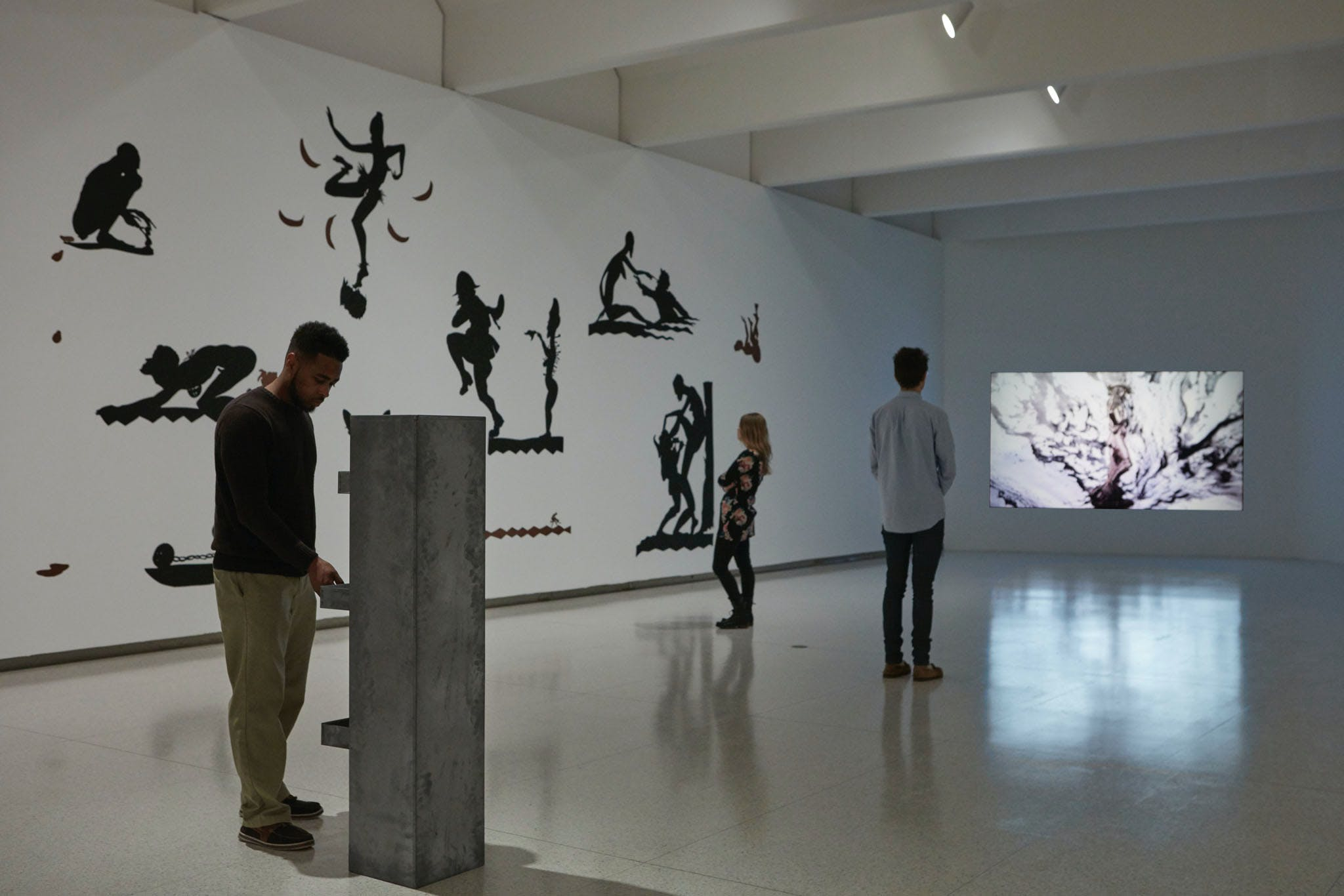 View of the exhibition Less Than One, 2016; (left to right) Kara Walker, Endless Conundrum, An African Anonymous Adventuress, 2001; Trisha Donnelly, Untitled, 2014 (Photo: Gene Pittman, ©Walker Art Center)