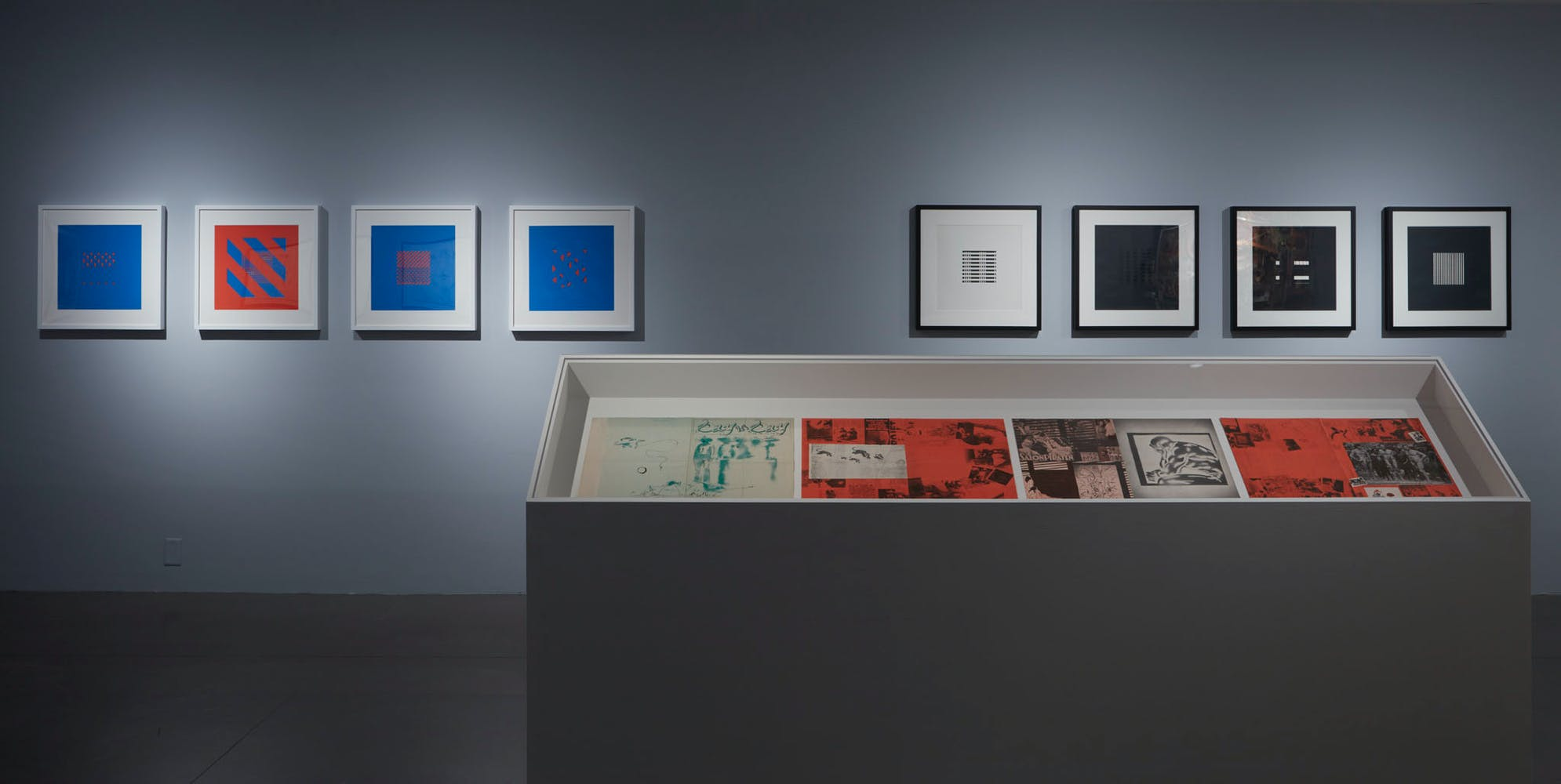 View of the exhibition Less Than One, 2016; (left to right): Dieter Roth, FC, 1958-1965; Dieter Roth, AC, 1958-1964; (foreground): Sigmar Polke, Day by Day . . . They Take Some Brain Away, 1975 (Photo: Gene Pittman, ©Walker Art Center)
