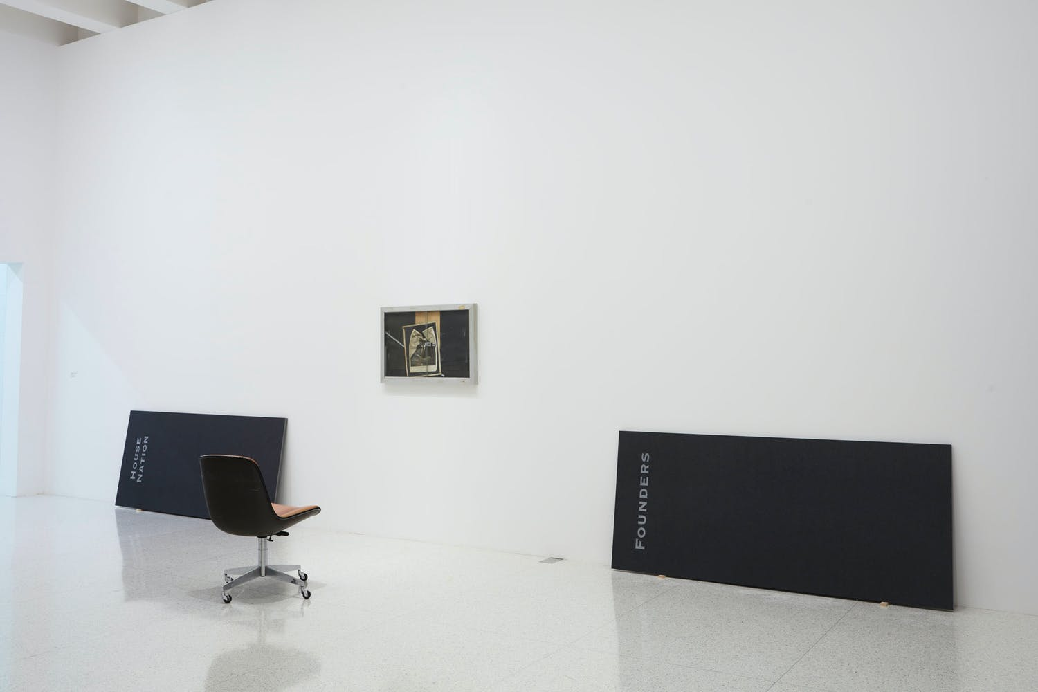 View of the exhibition Question the Wall Itself, 2016; (left to right) Theaster Gates, House Nation Plaque, 2016; Theaster Gates, A Maimed King, 2012; Theaster Gates, Founder's Plaque, 2016 (Photo: Gene Pittman, ©Walker Art Center)