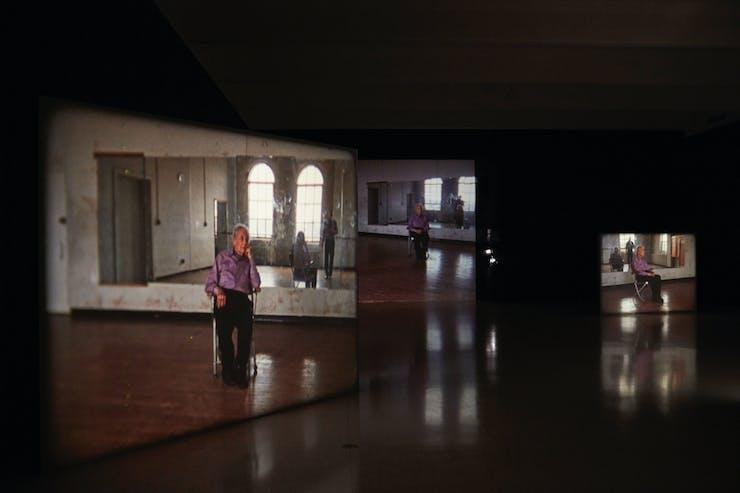 Exhibit hall with Merce Cunningham performing STILLNESS.