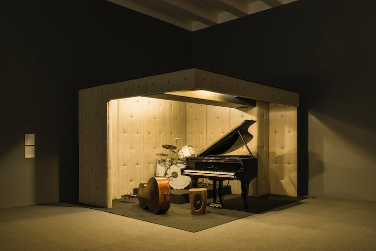 Dark staged room with a piano