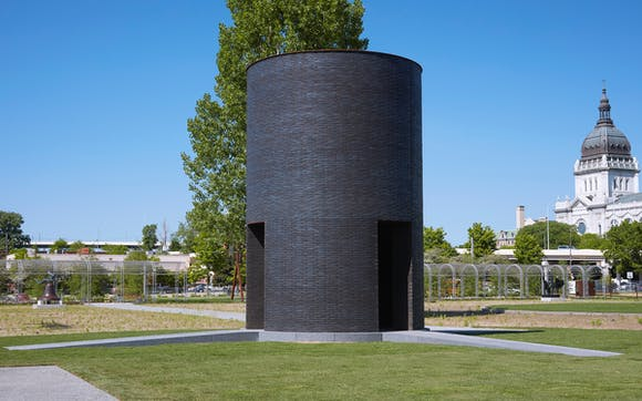 Black brick round tower in Minneapolis Sculpture Garden