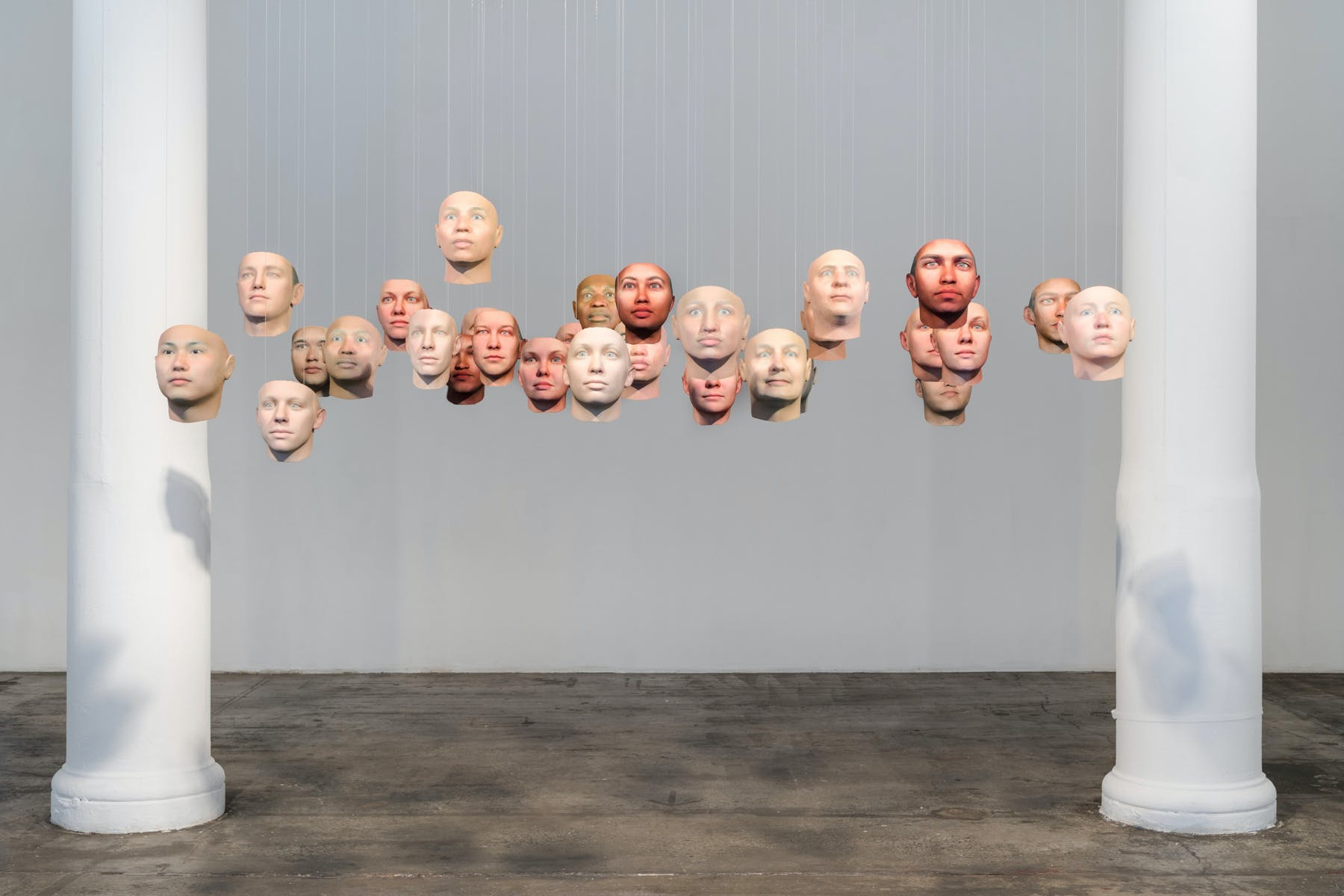 20 floating heads in a gallery with two columns