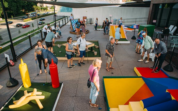 People playing Skyline Mini Golf on the Terraces