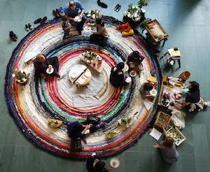 a group of people weaving together