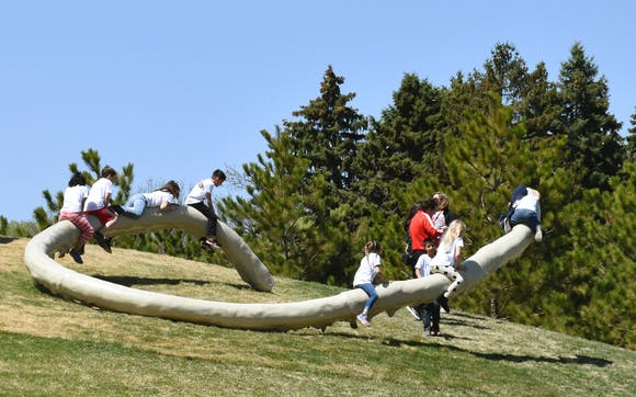 students playing on a sculpture in the Walker Art Centers upper garden