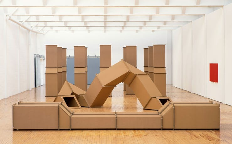 Cardboard ventilation systems are arranged in a gallery space.
