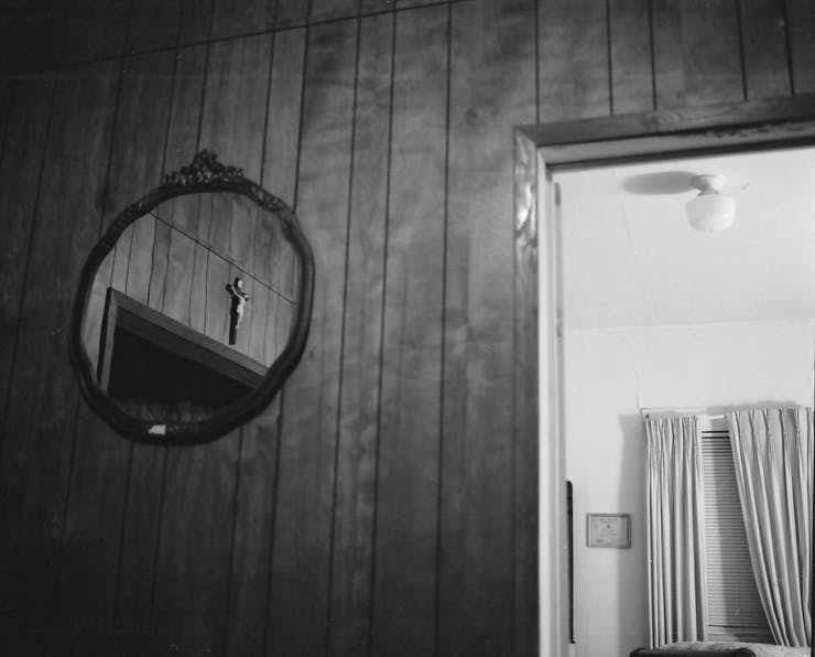 mirror on wooden wall